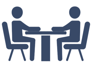 A blue icon of two people sitting at a table for an interview