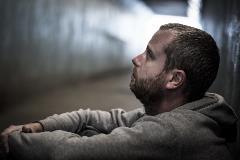 Homeless-adult-male-sitting-in-subway-tunnel-begging-for-money-612508406_5472x3648